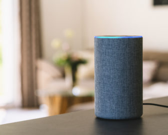 Amazon echo device sitting on table