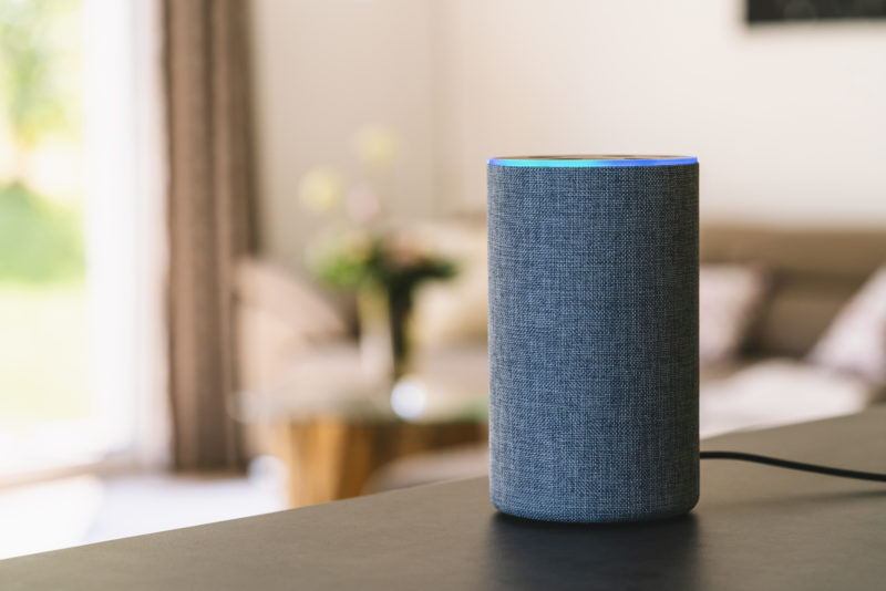 Amazon echo device sitting on table