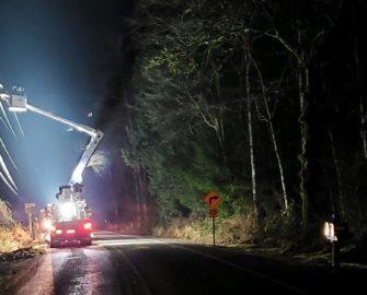 bucket truck at night working