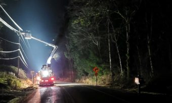 bucket truck at night working