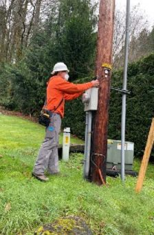 lineman working on power pole