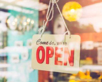 Come in, we're open sign on front door of business