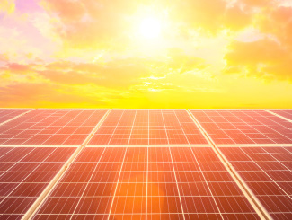 sun shining on solar panels