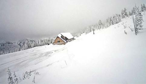 Cabin in snowy mountains