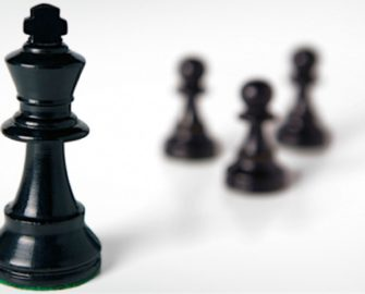 Chess pieces: king and three pawns