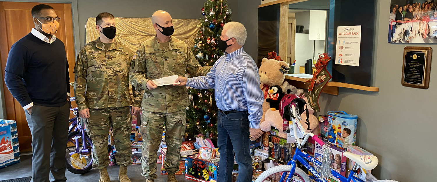 man giving check to army
