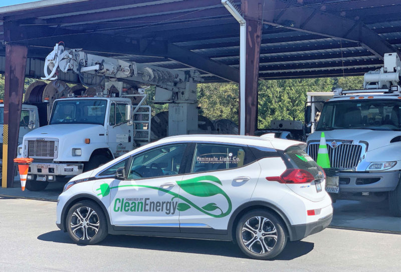 PenLight Clean Energy car at a gas station.